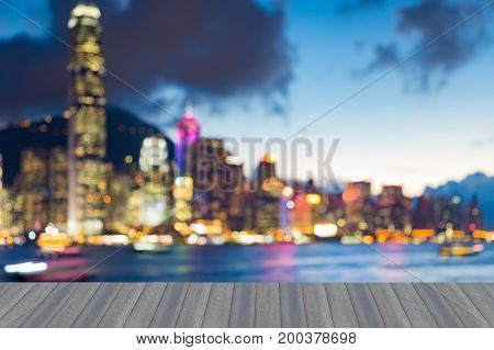 Opening wooden floor Twilight blurred bokeh light Hong Kong city downtown abstract background