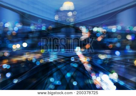 Double exposure Motion blurred moving train with city bokeh light night view abstract background