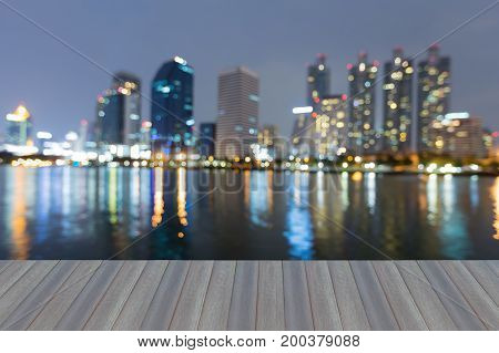 Opening wooden floor Twilight blurred bokeh city office building blurred bokeh light abstract background