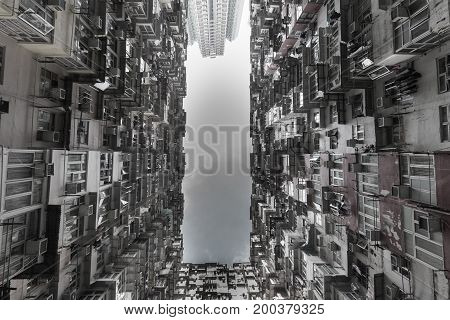 Bottom view Hong Kong crowded apartment cityscape downtown background