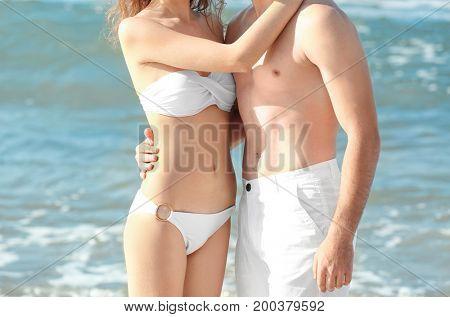 Beautiful young couple at sea resort