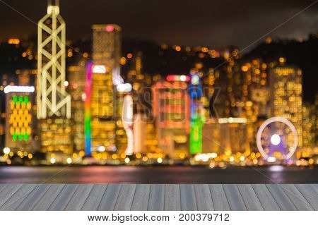 Opening wooden floor Hong Kong night blurred light downtown abstract background