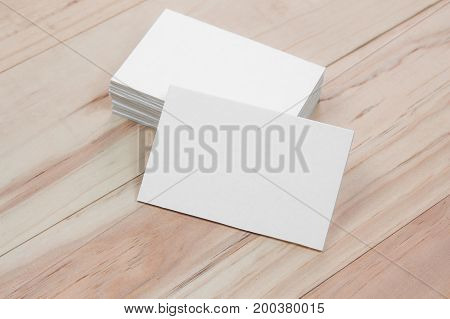 White business card on wooden table. mock-up paper