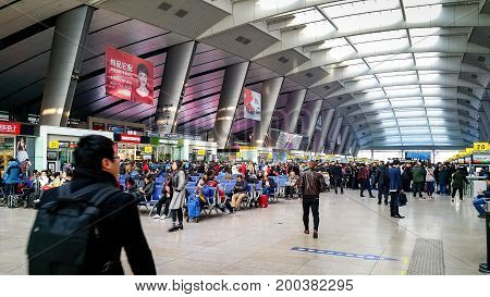 Beijng, China - Oct 31, 2016: At Beijing South (Beijingnan) Railway Station in the Fengtai District. This station serves mainly high speed trains. Passengers wait around the entrance gates.