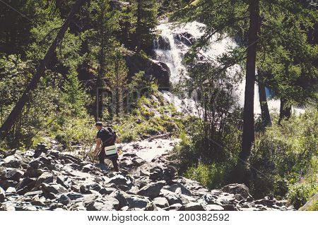 A Beautiful Waterfall In The Forest.