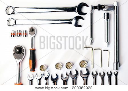 Top view of Working construction and mechanic toolswrenchsocket safty helmetsafety glasses wrenchhammerscrewdriverplierelectric drilltape measuremachinist square on white background. flat lay.