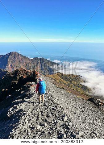 Traveler walk on the way to Rinjani mountain Summit, Lombok, Indonesia