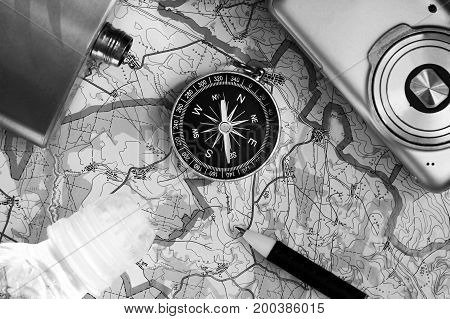 Compass And A Camera On The Map