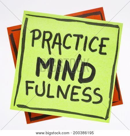 Practice mindfulness reminder - handwriting on an isolated sticky note