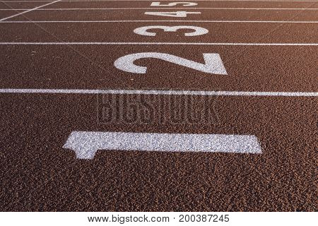 Sprinting track showing the numbers near a starting line