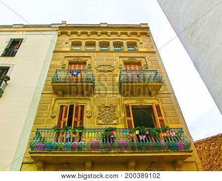 Tossa de Mar, Spain - September 14, 2015: The balcony at old house at Tossa de Mar old town in Costa Brava of Catalonia, Spain on September 14, 2015
