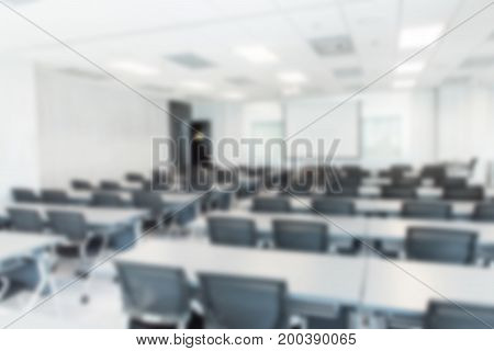 blurred background of a conference hall or seminar room.