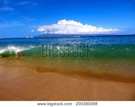 Powerful Turquoise Wave Cresting on Kaanapali Beach, Lahaina, Maui, Hawaii.