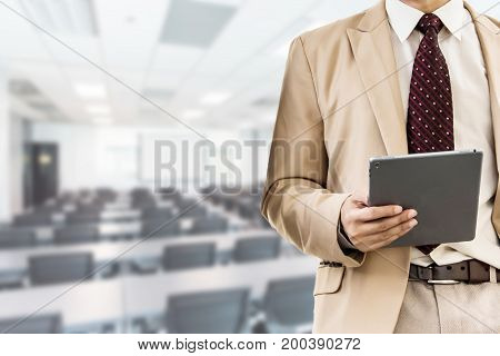 businessman using the Tablet business people forum Meeting Conference Training Learning Coaching Concept blurred background