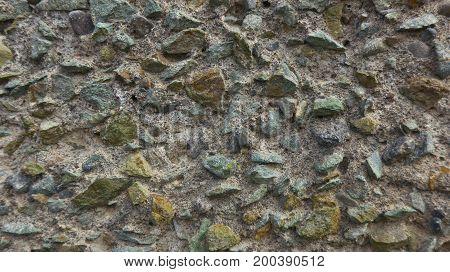 The wall of acute stones. Macro photography monochrome.
