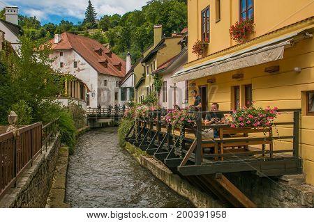 CESKY KRUMLOV, CZECH REPUBLIC - AUGUST 13, 2017: Restaurant near Vltava river in the historic center of Cesky Krumlov