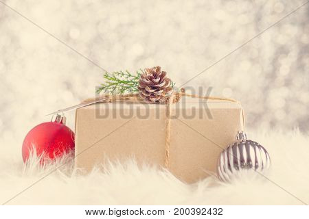Brown Paper Craft Warped On Present Box Decorate With Pine Cone And Green Leaf Christmas Ball At Spa