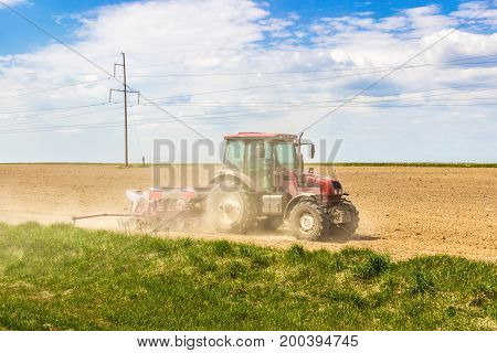 Tractor planting in the field in spring
