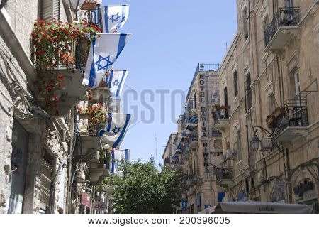 Jerusalem, Israel - May, 2012: Jerusalem street with balconies and flags in Israel, in May 2012