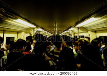 crowd in the Metro sky train on rush hour bangkok thailand