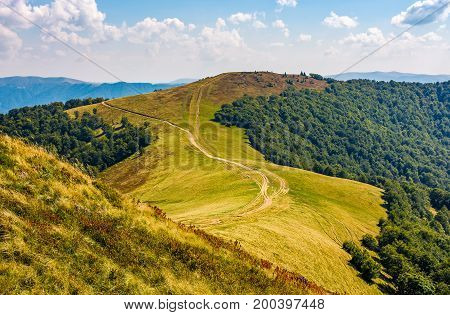 Path Through Grassy Meadows On Mountain Ridge