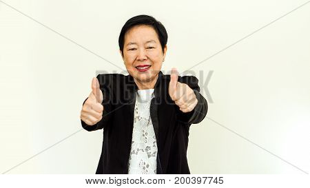 Asian Senior Woman Wearing Suit With Happpy Face And Hand Gesture On White Background