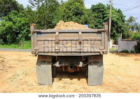 Dump Truck Of  Soil At Construction Site