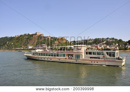 Mosel, Germany - August 2012: Passenger boat on Mosel river with poeple onboard, in August 2012