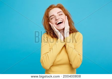 Lifestyle concept - Portrait of cheerful happy ginger red hair girl with joyful and exciting smiling to camera. Isolated on Blue Pastel Background. Copy space.