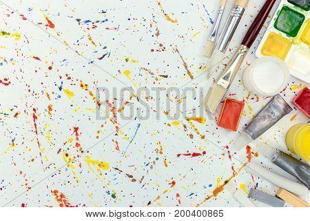 Aquarelle Palette, Gouache Buckets And Various Paintbrushes