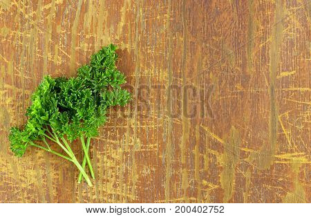Fresh parsley on wood background, tasty, natura, top view
