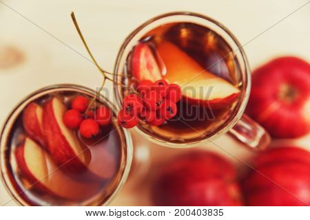 Beverage with autumn fruits.Apple,rowan berry.Autumn background.Fall concept.top view