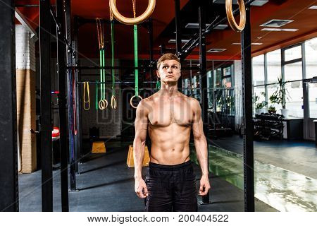 Exercises On Rings. Workout In Dark Gym