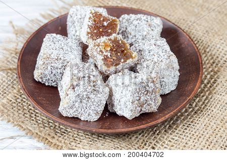 Rakhat-lukum Sprinkled With Coconut Shavings On A Clay Plate.