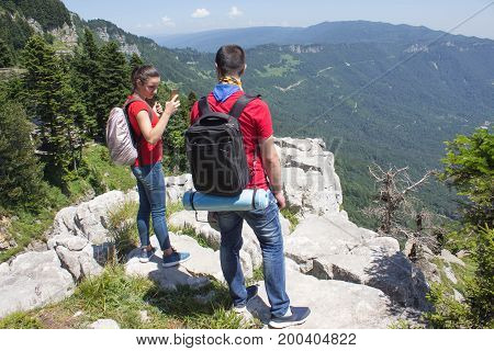 Travelers travel In the mountains reserve. Trekking together. Active and healthy lifestyle on summer vacation and weekend tour