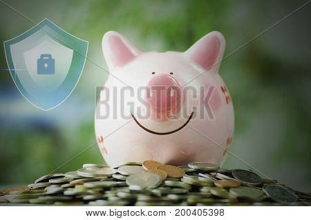 piggy bank on stacked on money coin with protection and save concept