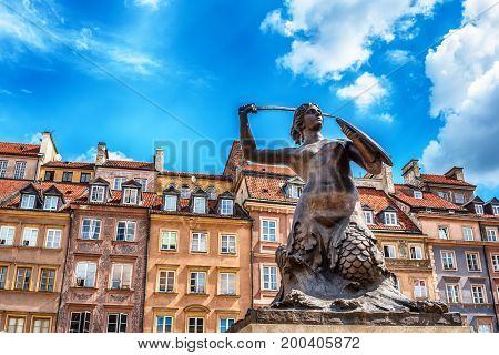 The Statue of Mermaid of Warsaw, Polish Syrenka Warzawska, a symbol of Warsaw in the old town of city