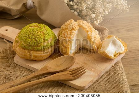 Choux Cream On Plate. Cream Puffs Filled Vanilla And Milk Custard