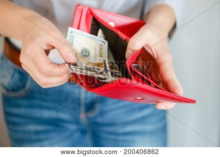 Close Up Woman Hand Holding Wallet And Counting Money