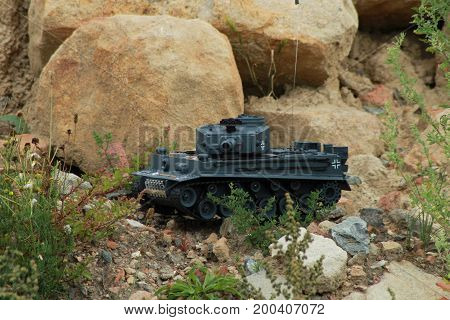 Radio control army tank on rock/ This is a model  German army tank.