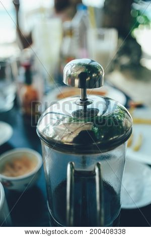 French press coffee maker in a cafe bar. close up image toned image selective focus