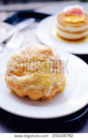 Pinoy Ensaymada bread with sugar and cheese on top