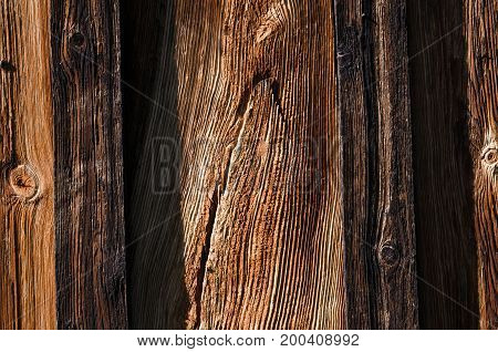 The texture fresh dark wooden boards are arranged vertically. Horizontal photo color photo wallpaper