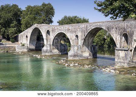 Ancient famous bridge across the river Arachthos (Greece, Arta, Epirus region)