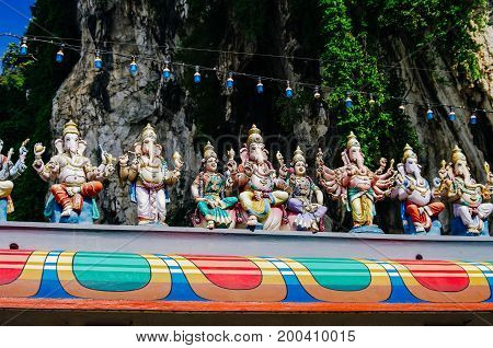 Statue of Ganesha and other Hindu deities on the roof of temple within Batu Caves. Batu Caves - a complex of limestone caves in Kuala Lumpur Malesia