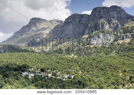 View of the village in the mountains on a sunny day (village Papigo, Epirus region, Greece).