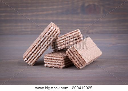 Waffles with sweet filling on a wooden background.