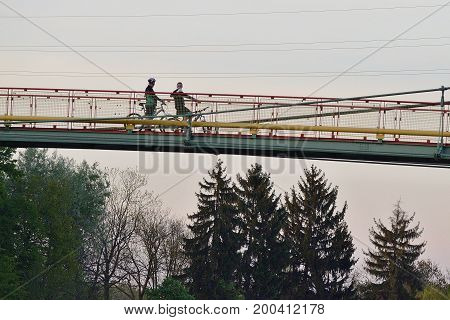 10 of may 1016, Editorial photo of two two bikers who is take a rest and talking about on the Labe bridge. Lazne Tousen, Tousen spa, Czech Republic