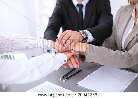 Business people group joining hands and representing concept of friendship and teamwork.