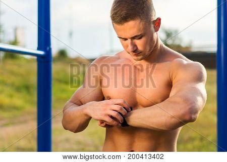 Man Measuring Time On During Street Workout